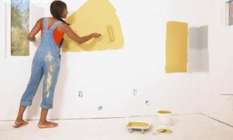 person painting wall
